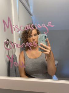 Woman standing in mirror which says Miscarriage Changes You